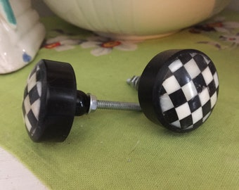 Pair of Black and white check knobs.