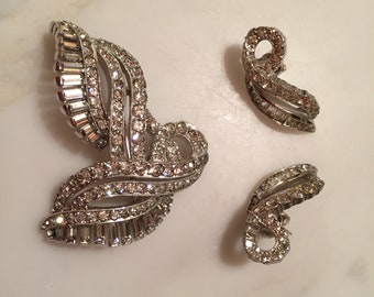 """Vintage Kramer silver tone/rhinestone brooch and earring set. In excellent condition. Brooch is 1.5"""" W x 2"""" L. Earrings converted to pierced"""