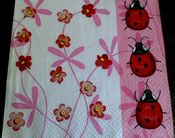 4 napkins of paper flowers and ladybugs
