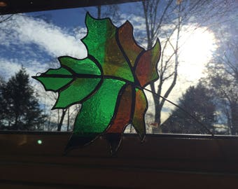 Green stained glass maple leaf