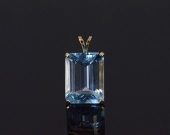 14k Blue Topaz Emerald Cut Prong Set Pendant Gold