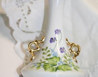 Hand painted vase; gold trim handles; fluted top; violets; pansies; artist signed; B-12