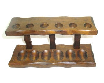 """Wood pipe stand, pipe rack, holds 6 pipes. Conventional looking wooden stand is 10.5"""" long and 5"""" tall. In good used condition"""