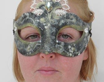 Black gold and white mask, with diamante and lace decoration and ribbon ties