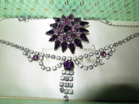 Lovely vintage set of silver metal  clear and amethyst rhinestone necklace and brooch