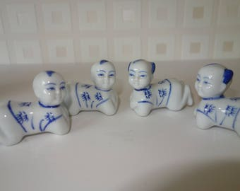 set of 4 blue and white Chinese boy chop stick rests