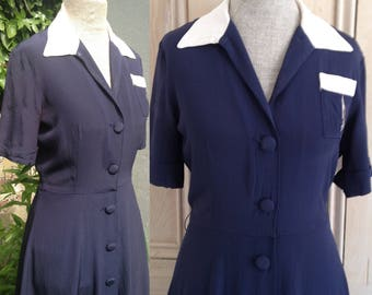 Vintage 1940s 1930s navy blue dress with off-white collar and pocket detail.