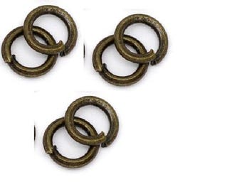 set of 100 rings plated bronze 4 mm