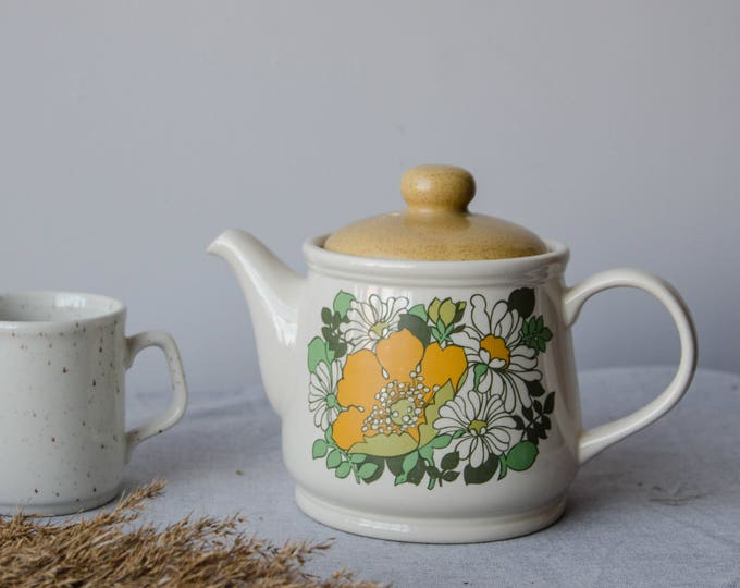 Vintage porcelain kettle with yellow flowers