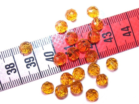 Faceted 6 mm Topaz round x 25