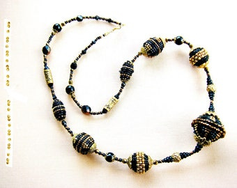 Necklace and 7 beads beadwoven bronze and black