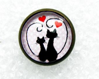 Bronze metal pins, cats in love