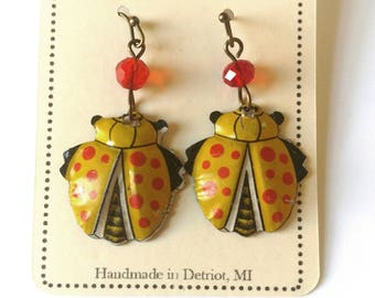 Yellow ladybug earrings made from vintage children's toys