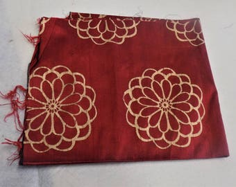 Great remnant of Red and Gold Dupion Silk. Red Dupion Silk with Large flower design.  Dupioni Silk. Fashion Fabric.