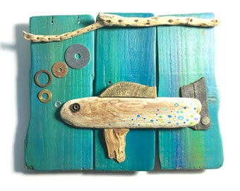 Upcycled wooden fish wall decor, using driftwood & other found objects, decorated and painted in shades of sea greens and blues, beach decor