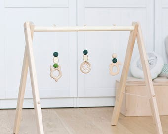 Wooden baby gym with hanging toys