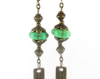 Bronze earrings * green howlite beads * bronze charms *.