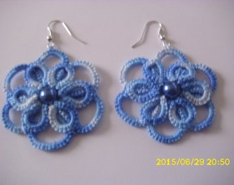 These earrings tatted in blue tone