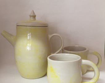 Yellow coffee pot and cups