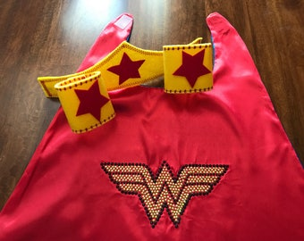 Wonder Woman Cape Set With Rhinestone Emblem, Headband , And Wristbands. The Perfect Outfit For Your Superhero To Save The Universe !!!