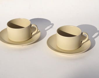 A set of Beige Tea/Coffee cups and Saucers
