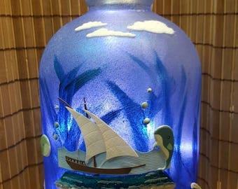 Beachy dolphin lighted wine jug.