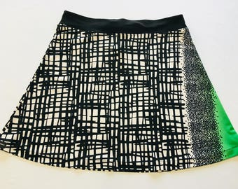 Black/Ivory/Splash of Green  Light Weight Stretchy Knit Skirt A-line Cut Skims over Hips Hidden Adjustable Tie in Waist Band