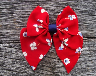Bow tie red brooch with blue flowers