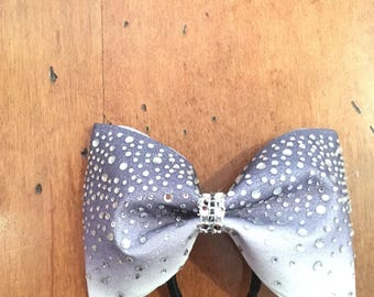 Purple to white ombre bow with rhinestones