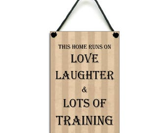 This Home Runs On Love Laughter & Training Handmade Home Sign 461