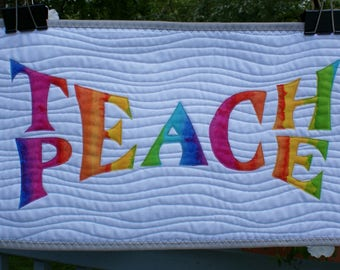 "Teach Peace quilted wallhanging in rainbow colors 10"" x 20"""