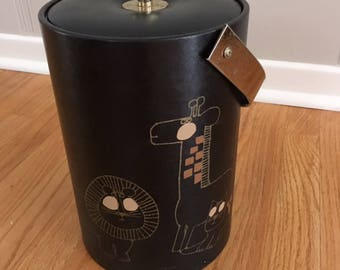 Mid Century Modern vintage Couroc Ice Bucket/Black with pencil type drawings of Giraffe/Lion/Hippo/Cat/brass handle