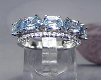 Decorated with 5 Blue Topaz silver ring size 52