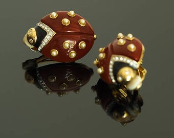 Ladybug signed by Kenneth Jay Lane clip earrings.