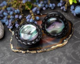 Black acrylic plugs decorated with shell-like stone (26-34 mm)