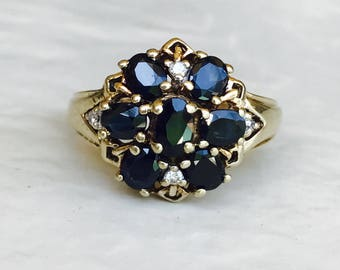 Sapphire and diamond cluster vintage ring in yellow gold