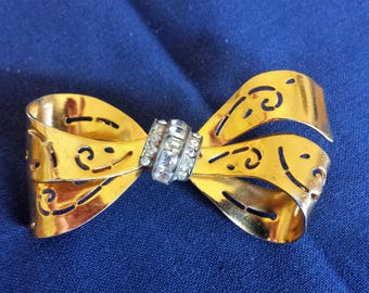 CORO Gold Tone Bow Brooch With Clear Rhinestones