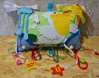Active toy - pillow for babys bed / carriage