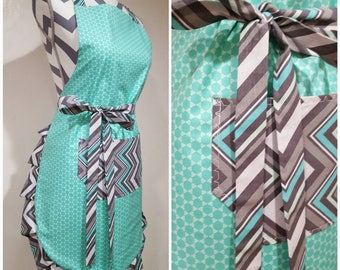 Adult apron. Woman's apron. Teal circles on main with teal, grays and white chevron on pocket, ties and frills.