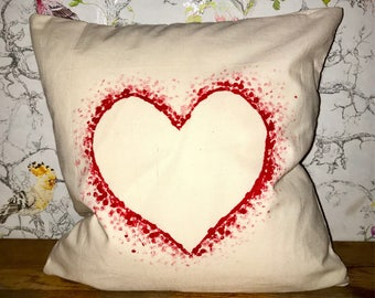 Dotted heart decorated cushion