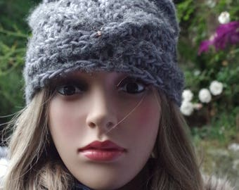 Grey or cream-colored braided merino wool cap