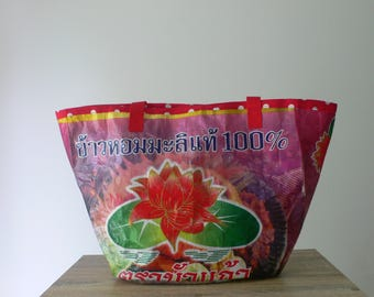 Handcrafted upcycled tote handbag from a recycled lotus flower rice bag