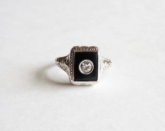 Antique Deco 18k White Gold Black Onyx and Diamond Filigree Ring. Circa 1930.Size  7 1/4.