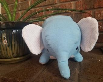 Blue elephant stuffed animal with polkadot accent