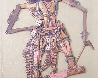 A vintage Javanese encased Wayang puppet