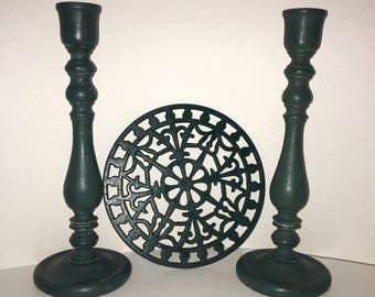 Set Of Wood Candleholders In Dark Green and cast metal hot plate trivet