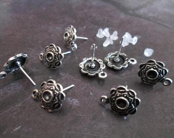 5 pairs of stud earrings in silver metal rings