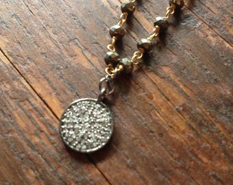 Genuine diamond pave disc necklace on a natural pyrite rosary chain.