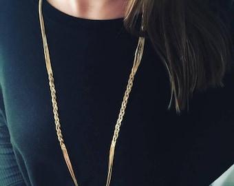 Golden neckless braided threads
