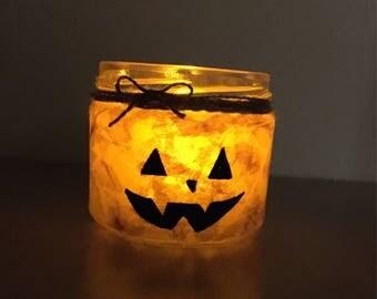 Halloween pumpkin candleholder jar